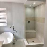 bathroom renovation with shower and separate soaker tub