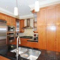 oak kitchen with granite countertops